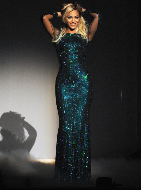 Beyonce performing at the Brit Awards 2014 in a sequin dress