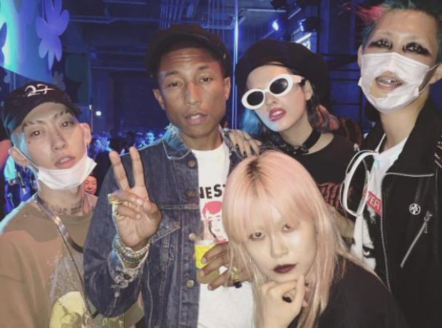Pharrell Williams with people in Tokyo