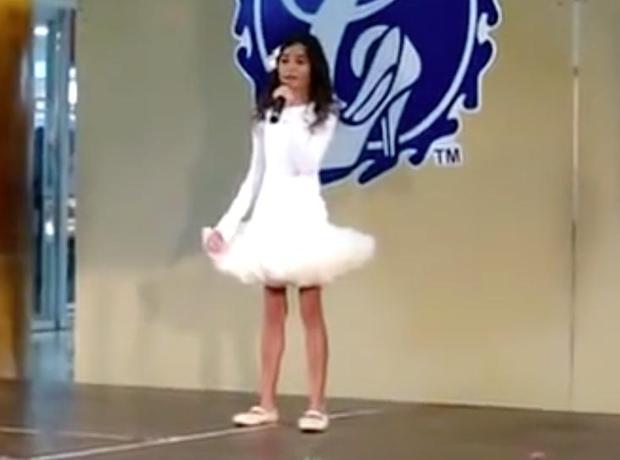 Pia Mia singing on stage