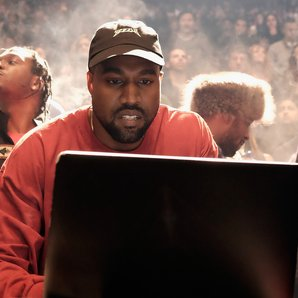 Kanye West looking at computer