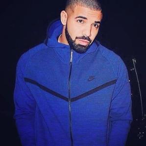 Drake wearing blue jacket