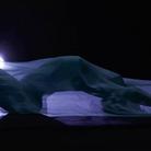 Rihanna laying under bed sheet