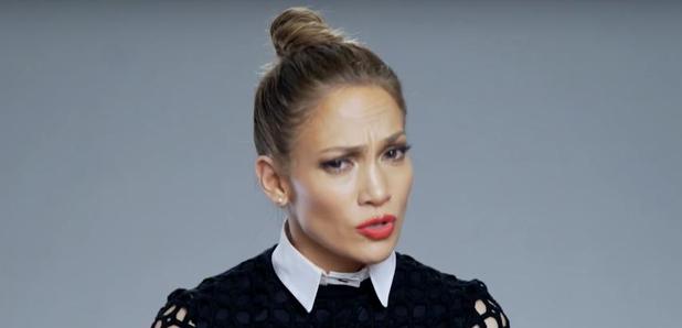 Jennifer Lopez reading from paper