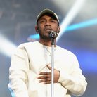 Kendrick Lamar performing on stage