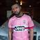 Image 7: Drake wearing football Shirt