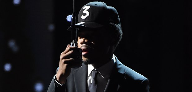 Chance The Rapper holding mic