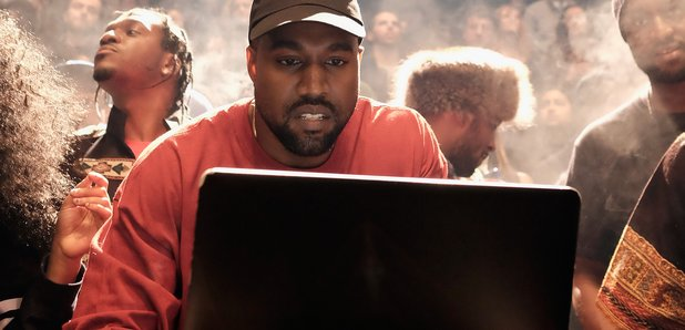 Kanye West Looking At Laptop