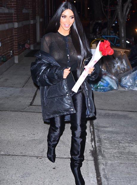 Kim Kardashian holding a bunch of roses